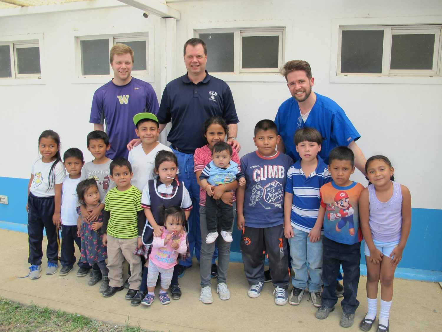 Dr. Plancich with kid patients from Open Wide Foundation