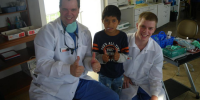 Dr. Plancich and Bryce with a Patient
