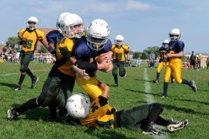 Group of kids playing football