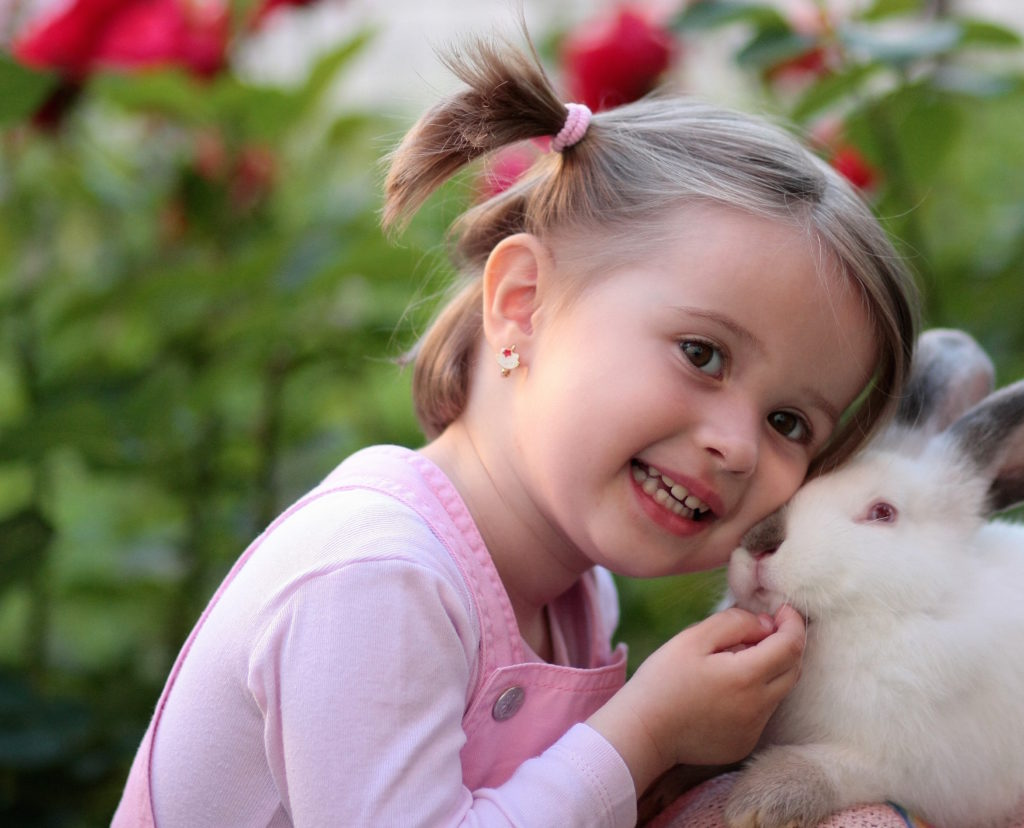 Little girl smiling with rabbit