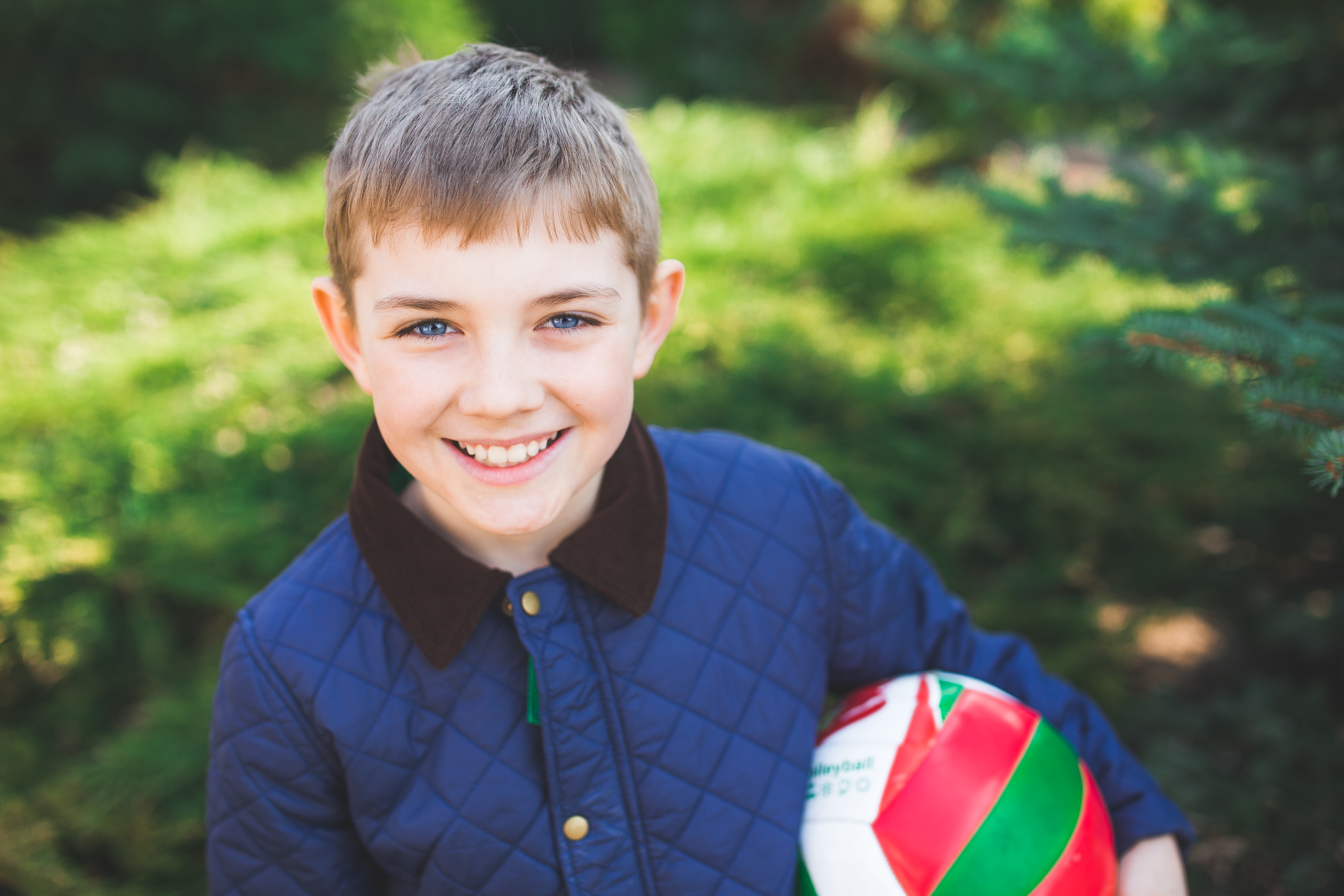 Boy smiling with ball