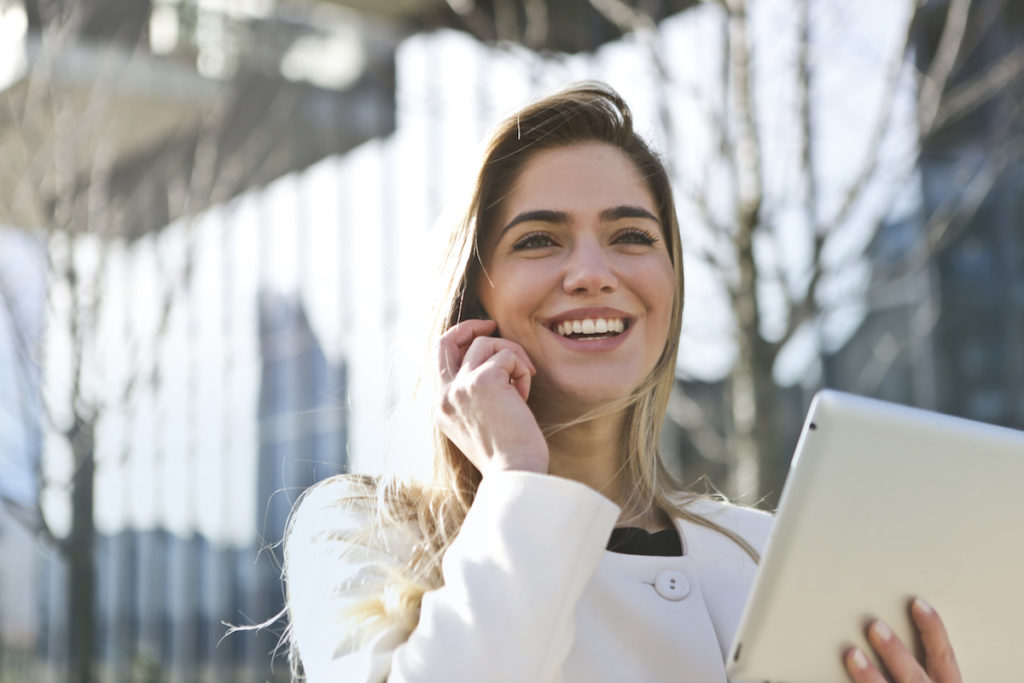 Woman smiling with iPad
